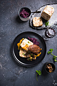 Vegan bread dumplings with soy-wheat steak, red cabbage and chestnut mushrooms