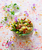 Quinoa salad with green asparagus, fruits and blossoms