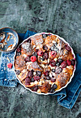 Croissant casserole with almonds and berries