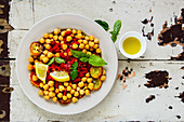 Chick pea salad with zucchini in plate