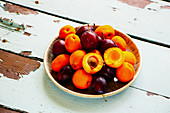 Organic summer fruit on wooden table
