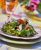 Summer mixed leaf salad with edible flowers