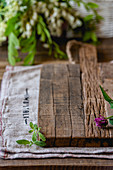A wooden chopping board with herbs