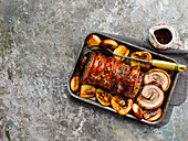 Roast belly pork with sage, cider and caramelized apples
