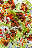 Lettuce with lentil balls and yoghurt dressing