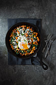 Sweet potato hash with spinach, smoked paprika, spring onion, garlic, grated cheese and fried egg