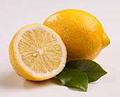 Lemon, lemon half and lemon leaves
