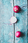 Radishes on blue wood