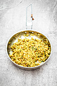Turmeric rice with ginger and peanuts