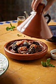 Veal tagine with dried plums and apricots
