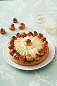 Saint-Honoré (a tart with a puff pastry base, glazed profiteroles and cream, France)