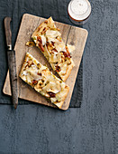 Tarte flambé with bitto cheese, bacon, leek and apple