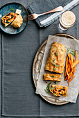 Carrot strudel with Provolone, Tuscan kale and walnuts