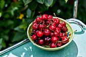 Cherries in a ceramic bowl