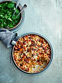 Baked chorizo and squash rice with manchego crust