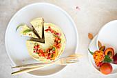 Raw vegan cashew cheesecake with oranges and nectarines