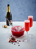 Pomegranate cocktails with Processo and Bourbon
