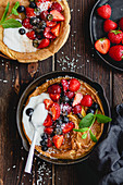 Dutch Baby with berries and coconut yoghurt