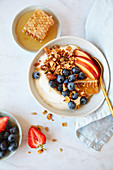 Breakfast Bowl of Yoghurt and Granola served with Fresh Fruit and Honey