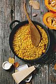 Traditional vegetarian pumpkin risotto italian dish in iron pan