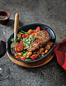 Pork neck prego on chorizo & beans