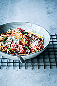 Spaghetti with tomatoes, spinach and a white wine sauce
