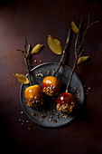 autumnal toffee apples with nuts, view from above.