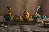 Small different pumpkins with condiments