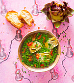 Pea and artichoke soup with dried tomatoes and pine nut crostini