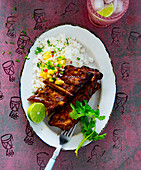 Jerk ribs with rice and mango salsa