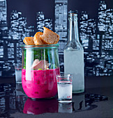 Beetroot soup with trout, dill and vodka in a preserving jar with grilled bread