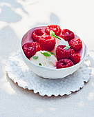 Lemon ice cream with raspberries and agave syrup