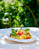 Semolina gnocchi with cherry tomatoes and basil