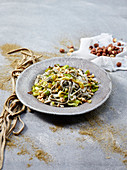 Hemp tagliatelle with leek and hazelnuts