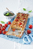 Chicken quiche with cherry tomatoes and pistachio pesto