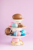Centerpiece composition of porcelain, colourful Easter eggs and chocolate eggs