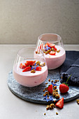 Strawberry cream with pistachio and almond brittle