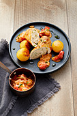 Turkey roulade with potato dumplings and cherry tomatoes