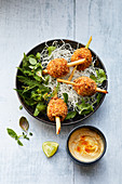 Lemongrass skewers with coriander, a peanut dip and a wild herb salad