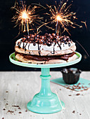 Chocolate meringue cake decorated with sparklers