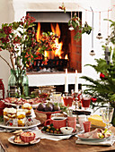 A Christmas buffet in front of a fireplace