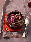 Octopus in red wine with red onions and majoram