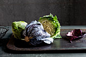 An arrangement of cabbages featuring red cabbage, pointed cabbage and Savoy cabbage