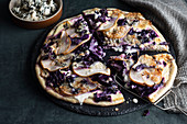 Red cabbage pizza with sour cream, pears and Roquefort cheese