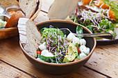 Mediterranean bowl with mozzarella and avocado