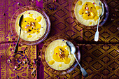 Rice pudding with mango sauce and cardamom