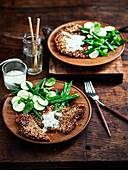 Vegetarian, gluten-free chickpea schnitzel and yoghurt sauce