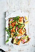 Smoked salmon and avocado kale pizza