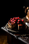 Vegan cheesecake with salted caramel sauce and raspberries
