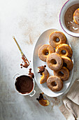 Baked donuts coated with cinnamon sugar and served with dipping chocolate sauce
